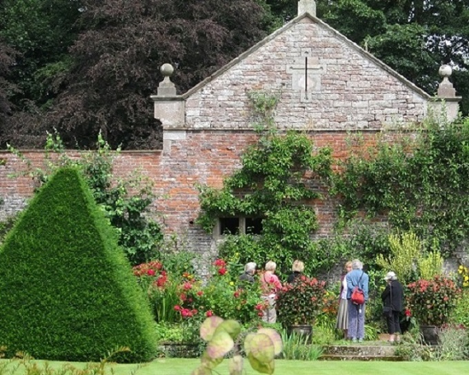 Lady Inglewood leads HPS Members through the walled garden at Hutton in the Forest